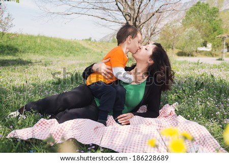 Mother and son kissing - stock photo