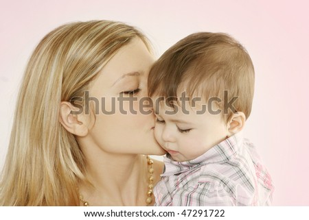 Mother and son, kissing