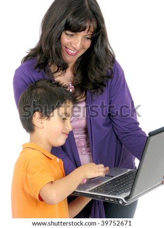 Mother and son looking and using laptop - stock photo