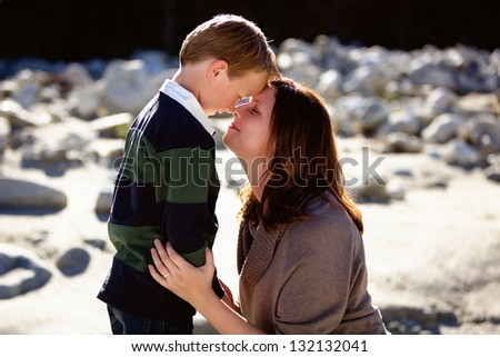 Mother and son loving one another in tender moment - stock photo