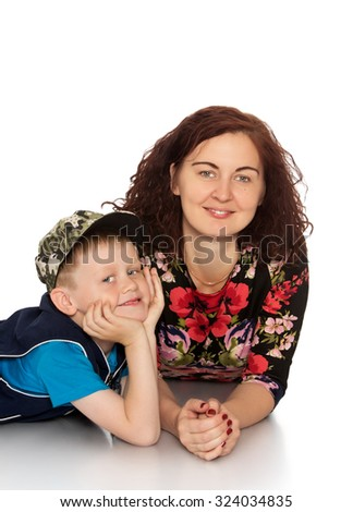 Mother and son lying on floor and smiling at the camera-Isolated on white background