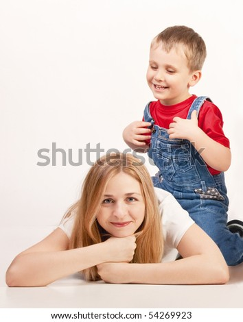 Mother and son lying on the floor - stock photo