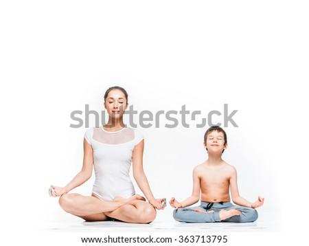 Mother and son meditating together. Concept of happy family, parenting, maternal care - stock photo