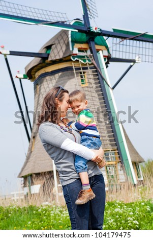 Mother and son near windmill in Holland - stock photo