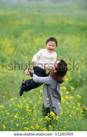 mother and son outdoor in flowers