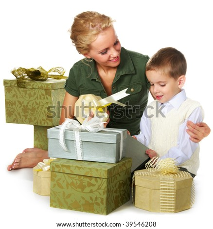 mother and son packing gifts - stock photo