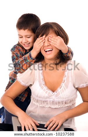 Mother and son playing hide and seek and working on laptop - stock photo