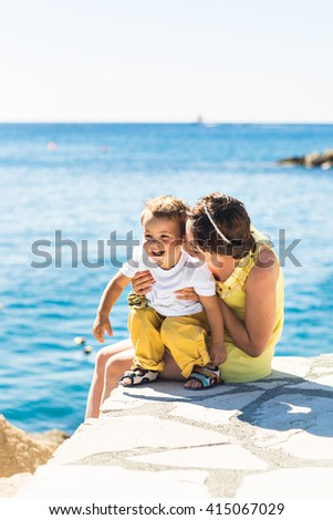 mother and son playing on the beach