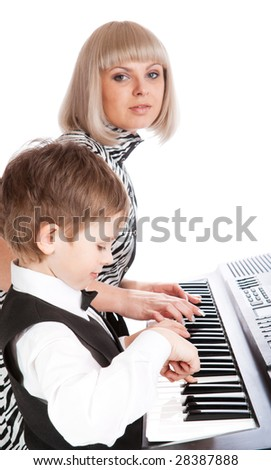 Mother and son playing piano together - stock photo