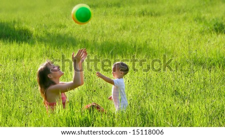 mother and son playing with colorful ball - stock photo