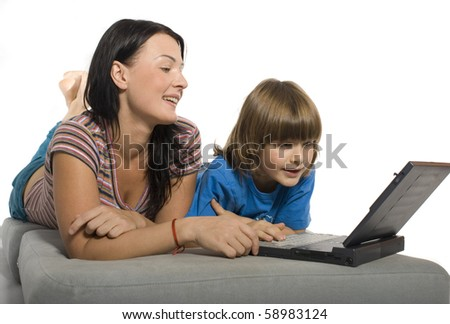 Mother and son playing with laptop - stock photo