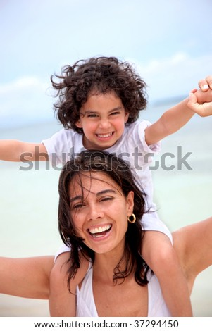 mother and son portrait having fun outdoors