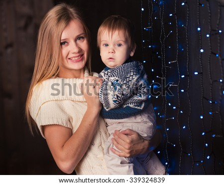 Mother and son portrait near wall with lights