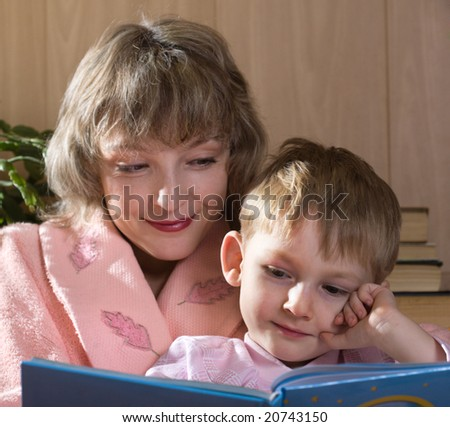Mother and son read book - stock photo