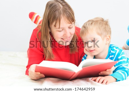 mother and son reading book at home, family leisure - stock photo