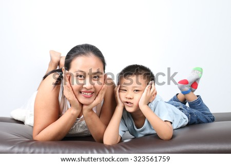mother and son relaxing on sofa - stock photo