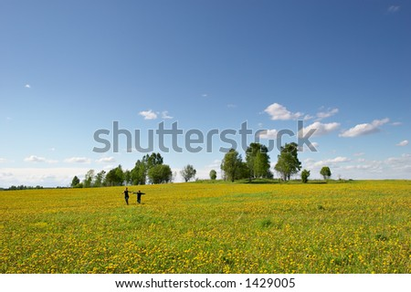 mother and son running on a flower meadow