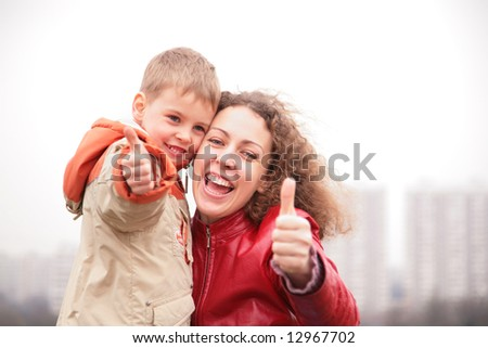 mother and son show ok gesture - stock photo