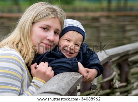 Mother And Son Smile Over Rural Background