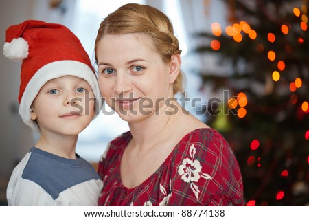 Mother and son smiling in christmas day - stock photo
