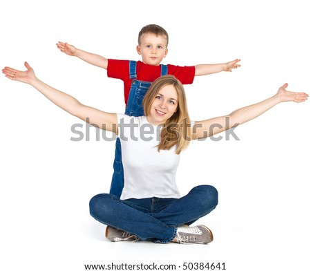 Mother and son spreading out their arms like flying plane - stock photo