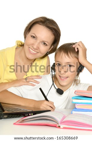 Mother and son studying together