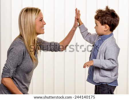 mother and son symbol of love, fun, childhood, happiness - stock photo