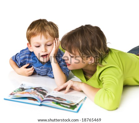 Mother and son together read the book - stock photo