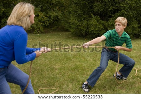 Mother and Son Tug of War - stock photo