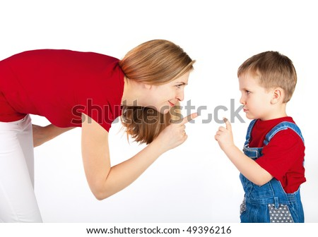 Mother and son wag their fingers to one another - stock photo