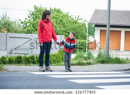 Mother and Son waiting to crossing the Road - stock photo