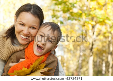 Mother and son walking in a park - stock photo