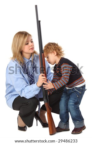 Mother and son with father's gun - stock photo