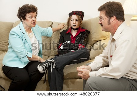 Mother and teen daughter in family counseling.