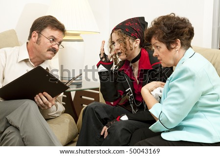 Mother and teen daughter in family counseling.  (bandana and jacket are generic, no logos or trademarks)