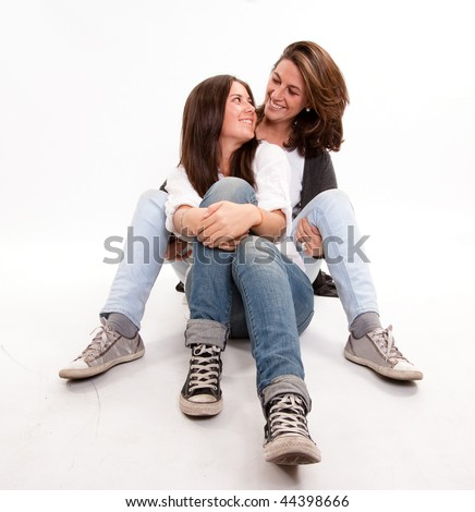 Mother and teen daughter looking at each other with love - stock photo