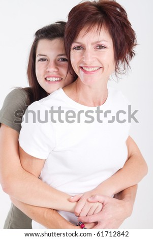 Mother and teen daughter portrait - stock photo