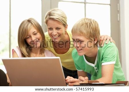 Mother And Teenage Children Using Laptop At Home - stock photo