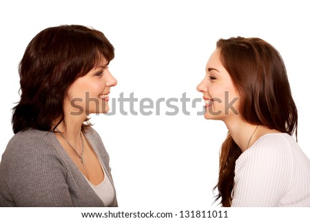 Mother and teenage daughter talking and laughing together. Happy family. A side view. Isolated on white background - stock photo