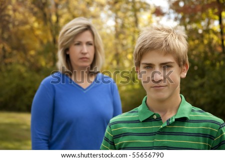 Mother and Teenage Son at Odds - stock photo