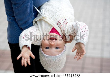 Mother and the child in park they play - stock photo