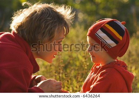 Mother and the child on walk - stock photo