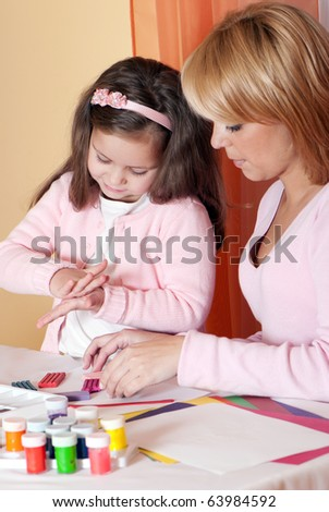 Mother and the daughter mould from plasticine - stock photo