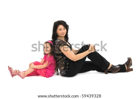 Mother and the daughter sit a back to each other