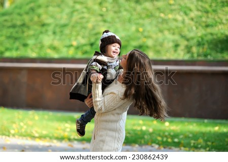 mother and the kid walk in the autumn park  - stock photo