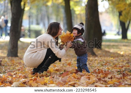 mother and the little son together walk in the park - stock photo