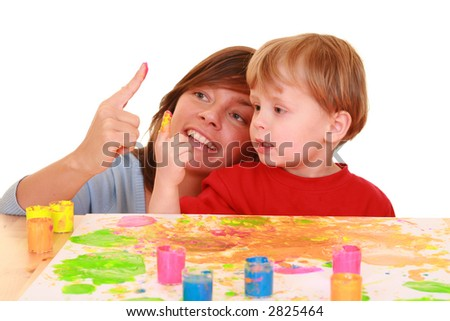 mother and three years boy painting isolated on white