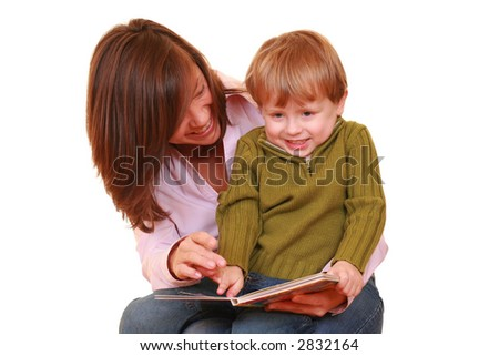 mother and three years boy reading a book isolated on white