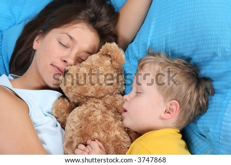 mother and three years old boy sleeping together