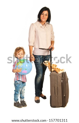 Mother and toddler boy with world globe ready for travel isolated on white background - stock photo